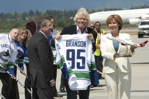 Sir Richard Branson (centre) was welcomed by Larry Berg, Vancouver Airport president and CEO and B.C. premier Christy Clark in May 2012 as Virgin began direct Vancouver-London summer seasonal service, which returns to YVR for the 2013 summer season.