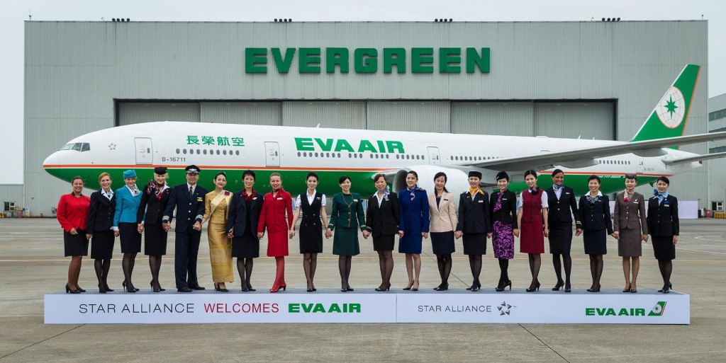 Staff representatives from Star Alliance airlines join hands in front of an EVA Air Boeing 777-300 ER to welcome the Taiwanese carrier into the Star Alliance family. EVA Air, which joined Star Alliance on June 18, 2013, is part of Taiwan's Evergreen group.