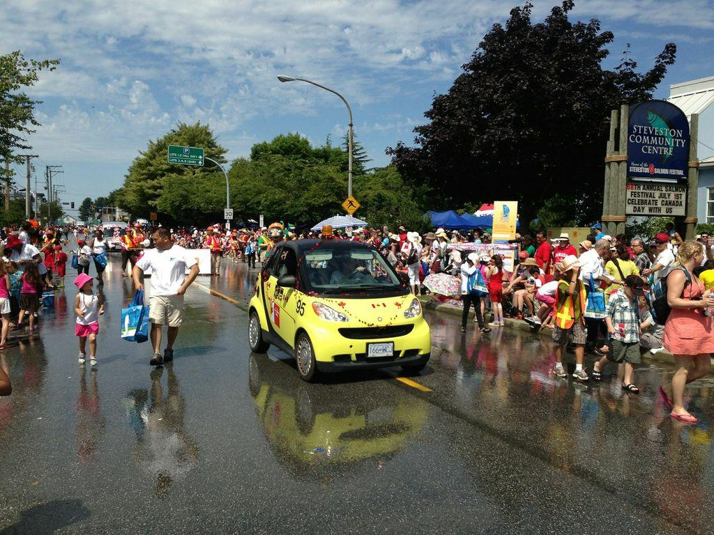 The YVR SmartCar cruises down Mocton Street in Steveston during the 2013 Canada Day Steveston Salmon Festival.