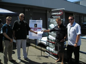 (left to right) Rob Favel, Pacific Coastal Airlines; Kevin Boothroyd, Pacific Coastal Airlines; Lyle Gibson, Cargojet YVR; and Shawn Warneboldt, Pacific Coastal Airlines. Pacific Coastal Airlines provided return tickets to Victoria worth $716 to be used as a raffle prize.