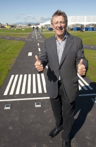 Larry Berg, former president and CEO Vancouver Airport Authority, gives the thumbs-up at the September 27, 2013 opening of the new and improved Larry Berg Flight Path.