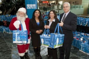 Santa Claus; Quest Food Exchange CEO Elizabeth Crudgington; YVR VP of community affairs Anne Murray and YVR CEO Craig Richmond at YVR's 2013 Christmas Hamper Drive event.