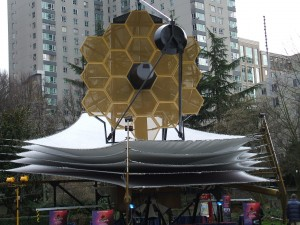 A model of the James Webb Telescope—a project of NASA, with international collaboration from the European Space Agency and the Canadian Space Agency, including contributions from 15 nations, it is estimated to be completed by 2018 at a cost of $8-billion.