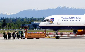 YVR ambassadors-turned-Vikings tug an Icelandair Boeing 757 aircraft to a gate at YVR, marking the airline's inaugural flight between Vancouver, Reykjavik and more than 20 European destinations.
