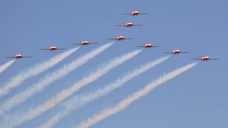 The iconic Canadian Snowbirds soar in formation at the 2014 Abbotsford Airshow. Photo: Tariq Jamil