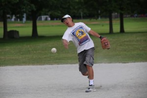 Gary Eng, general manager, Summit Customs Brokers, throws a slo-pitch.