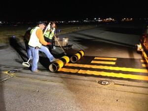 New thermoplastic markings are installed at one of the main taxiways on YVR's South Runway.