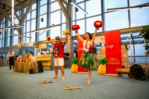 Hawaiian-themed dancers welcome Air Canada rouge new year-round non-stop service between YVR and Honolulu.