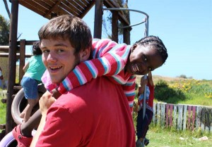 A Projects Abroad volunteer and a local child during playtime at a Care placement in Cape Town, South Africa.