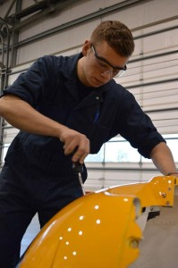 Cadet Ben Stipkala of 676  Kittyhawk Squadron, Sidney, B.C. installs an engine cowling air filter in a C182 tow plane.