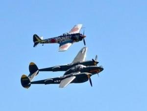 Lockheed P-38 Lightning twin engine, twin boom aircraft flies with a Japanese Nakajima Ki-43 (Oscar). Photo; Jim Jorgenson
