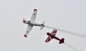 Father-son duo Bud and Ross Granley perform displays in Soviet aerobatic aircraft--Yak 18T Dual (white) and red Yak-SS. Photo: Jim Jorgenson