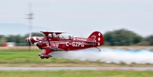 Former Canadian Snowbirds pilot Brent Handy flying a Pitts S-2b with some effect. Designed by Curtis Pitts in 1944, the Pitts Special is a light aerobatic biplane. Photo: Jim Jorgenson